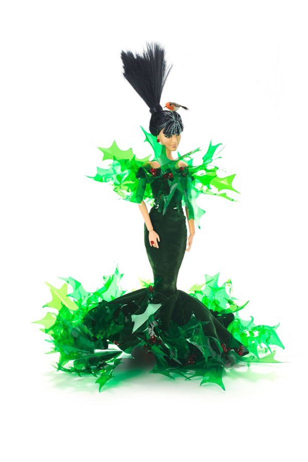 """<strong>Holly Surprise Barbie</strong> """"This is my personal favourite, using the contrast of soft velvet and spiky holly leaves. Barbie also has her very own pet Robin to give her a Christmas peck"""" - Stephen Jones"""