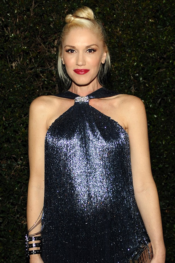 Talented Gwen Stefani steals the show with a statement red lip and lashings of mascara.