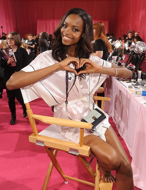 VS model backstage giving some love to the cameras