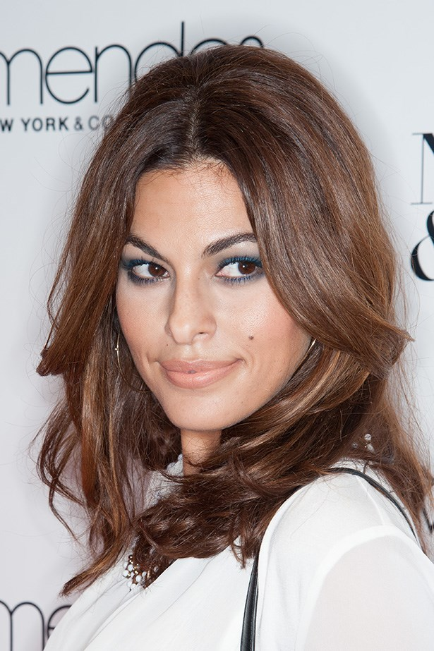 Sex bomb, Eva Mendez wore soft smoky teal shadow to the launch of her New York & Company fashion line. The muted blue shade kept Mendez's look sophisticated and chic.