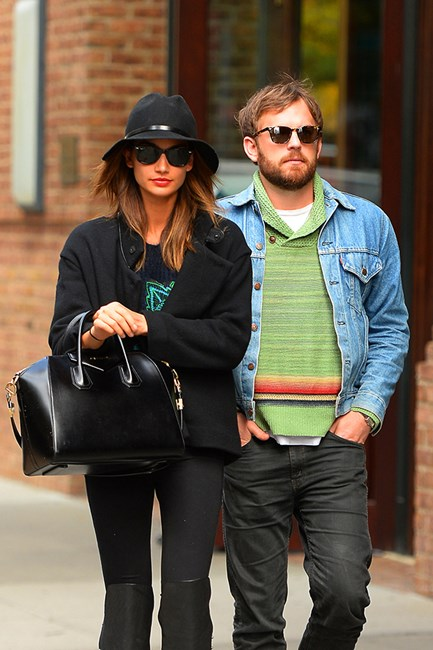 Lily Aldridge channels a rock star off-duty in a felt hat and oversized Givenchy Antigona bag, with musician husband Caleb Followill.