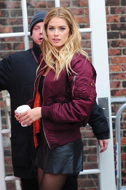 Dutch model and actress Doutzen Kroes stuns in a simple burgundy jacket and leather shorts.