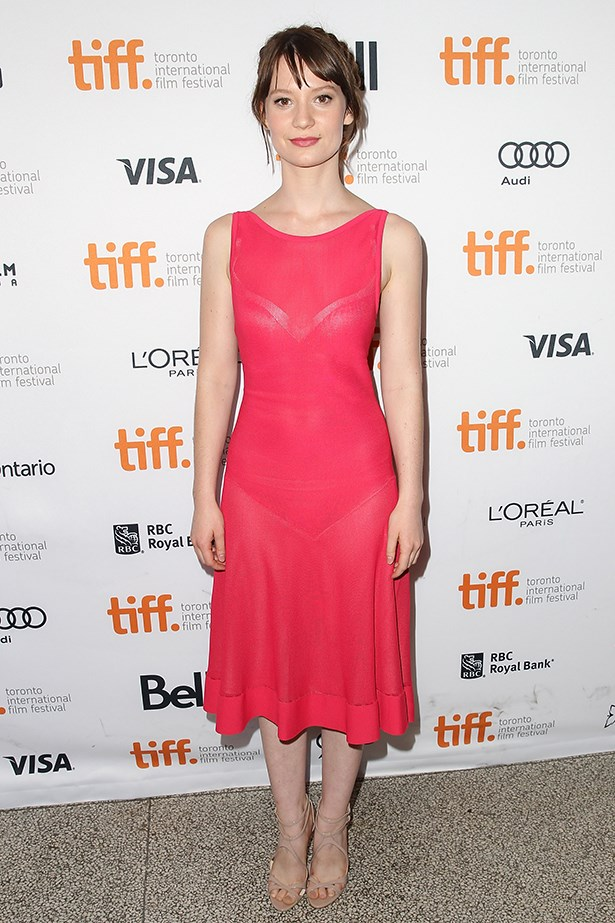 """<p><strong>Mia Wasikowska</strong><p/> <p>At the premiere in Venice of her latest movie, <em>Tracks</em>, the actress opted for a simple, elegant look – a Nina Ricci halterneck gown and satin open-toe Brian Atwood """"Wagner"""" platform pumps. A simple updo, diamond earrings and bright-red lipstick completed the look. </p>"""