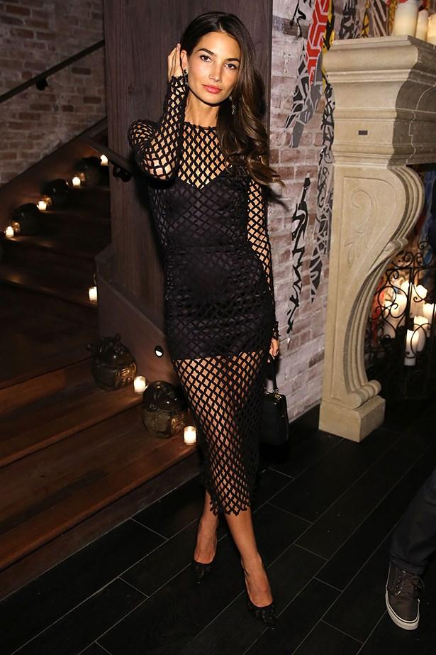 Aldridge wears a mesh Dolce & Gabbana dress and earrings to the Victoria's Secret after-party last week.