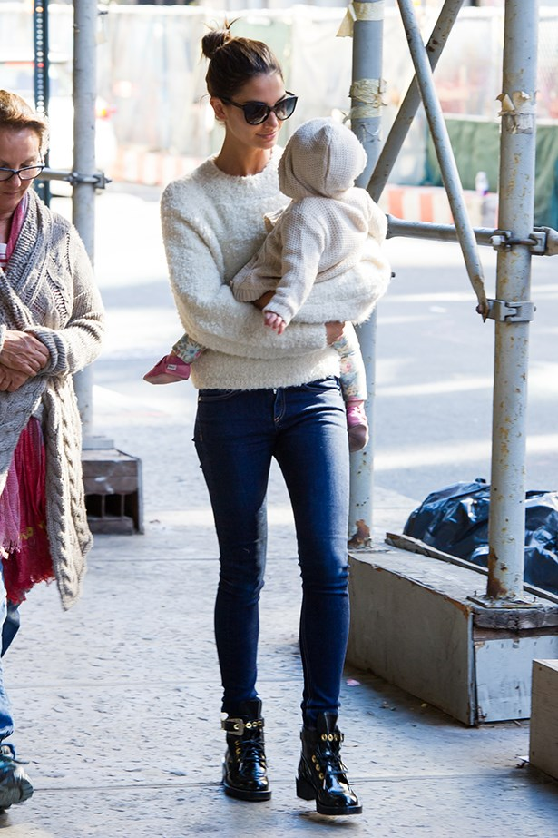 Aldridge with her daughter Dixie wearing a knit from The Row with jeans and boots.