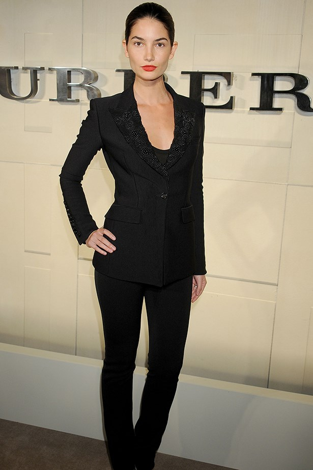 The model wearing a structured Burberry suit.