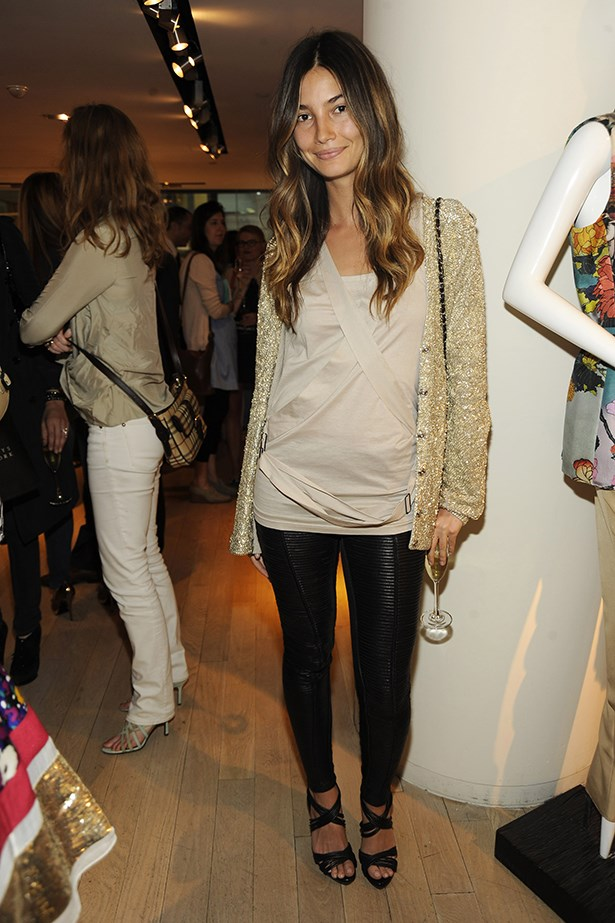 The model looking relaxed in leather leggings and a gold cardigan at Barneys in 2010.