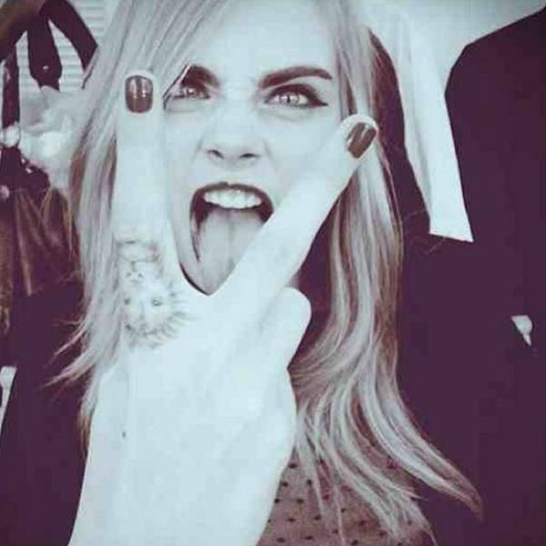 """<strong>Cara Delevingne</strong><br> The British model is <em>the</em> poster girl for the """"weird expression selfie"""", so much so that it's genuinely difficult to find one in which she looks normal."""