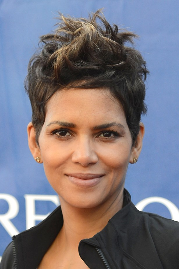 <strong>Oval</strong>: Oval shapes faces can carry off most cropped looks, as seen on Halle Berry. Layering around Berry's face contorts the length of her forehead. The playful volume on top can also be styled in many different ways: dishevelled curls or a sleek side sweep, to name a few.