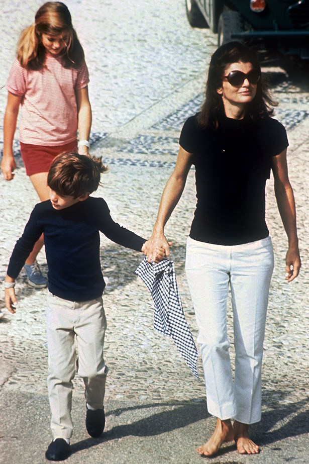 When in Rome! The former first lady makes barefoot look elegant in this black and white ensemble holidaying with her children.