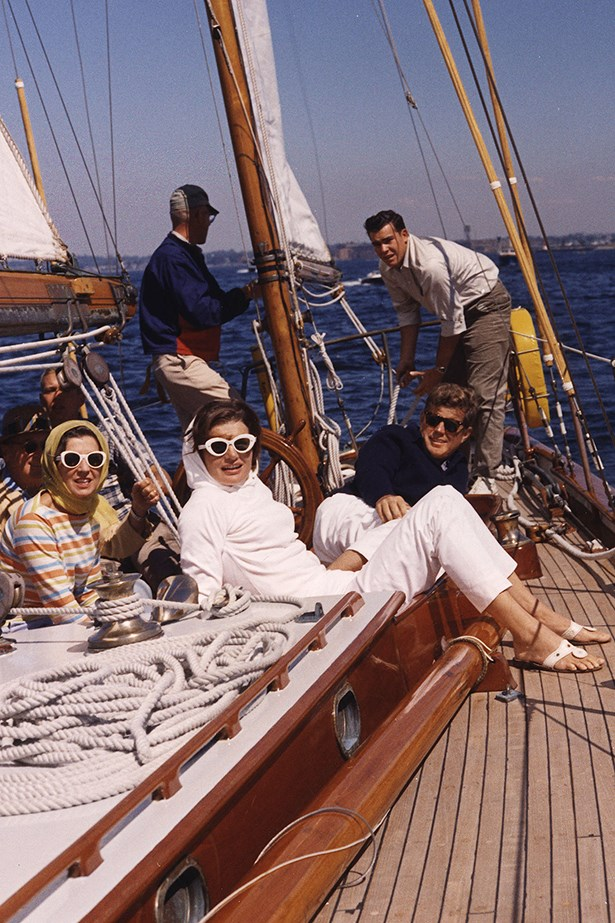 Jackie knows class in this all-white ensemble – and the scarf and sunglasses are the cherry on top. Here she watches the first America's Cup race.