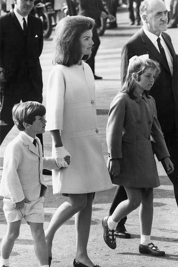 Freshening up her winter look, Jackie opts for a warm coat and matching gloves for a stroll with children, John and Caroline.