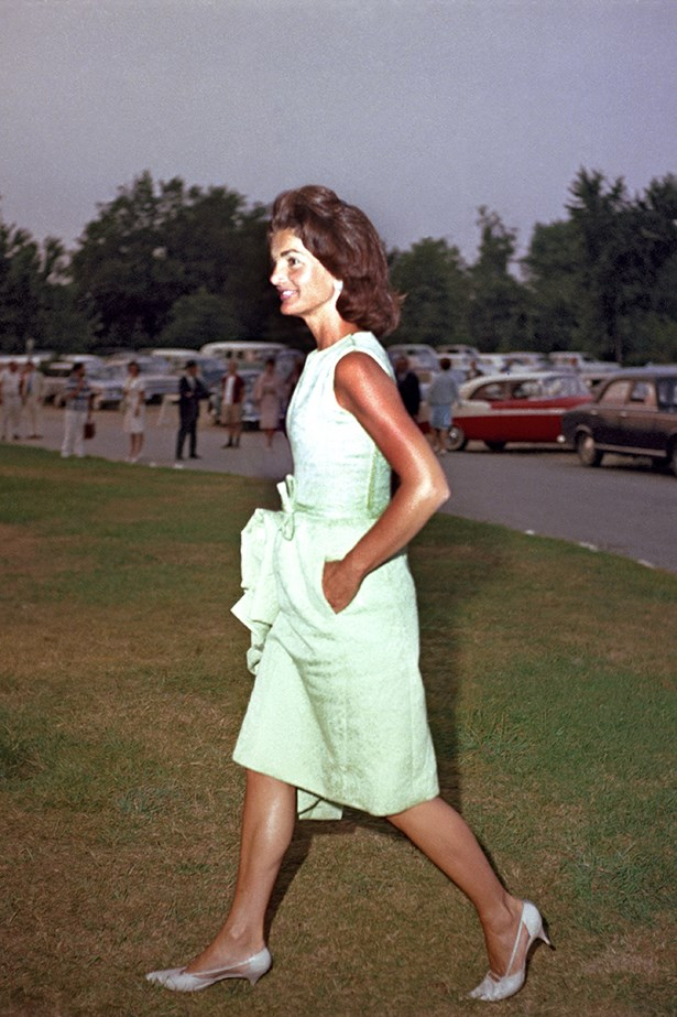 Even picnics have a dress code. Here she aces it in a green knee-length sleeveless dress and midi heels.