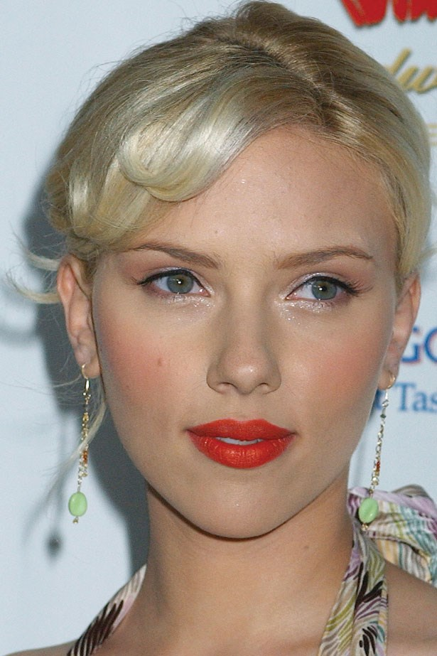 With platinum blonde locks and a bold red lip, Johansson channels old-Hollywood glamour at a 2005 gala event.