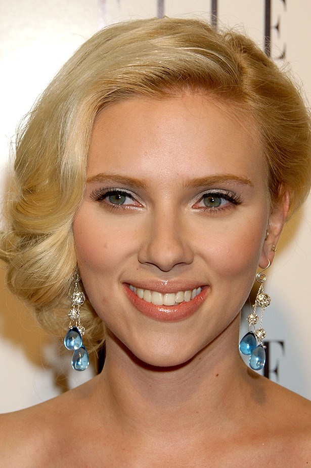 Johansson knows how to work a red carpet. She wore her hair curled, in a side swept bob coupled with major false lashes for a 2007 Elle event.