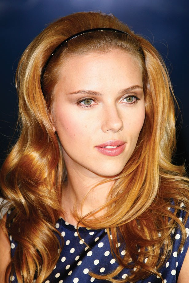 Sporting a black headband and blushing lips, Johansson's look at her album launch in 2009 is preppy and sweet.
