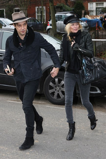Kate Moss opts for a military style cap and styles it with a leather jacket and faded black skinny jeans.