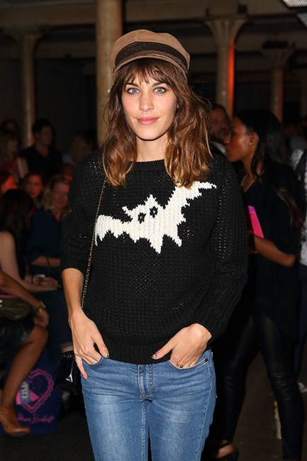 Alexa Chung styles her cap with a chunky knit and blue jeans.
