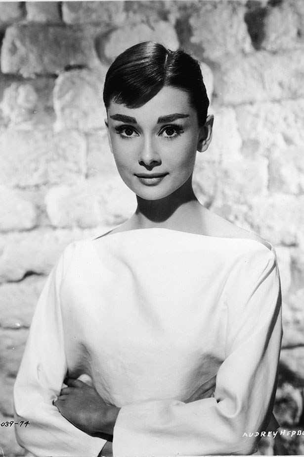 Audrey Hepburn makes us want to wear nothing but pearls and tailored pieces.