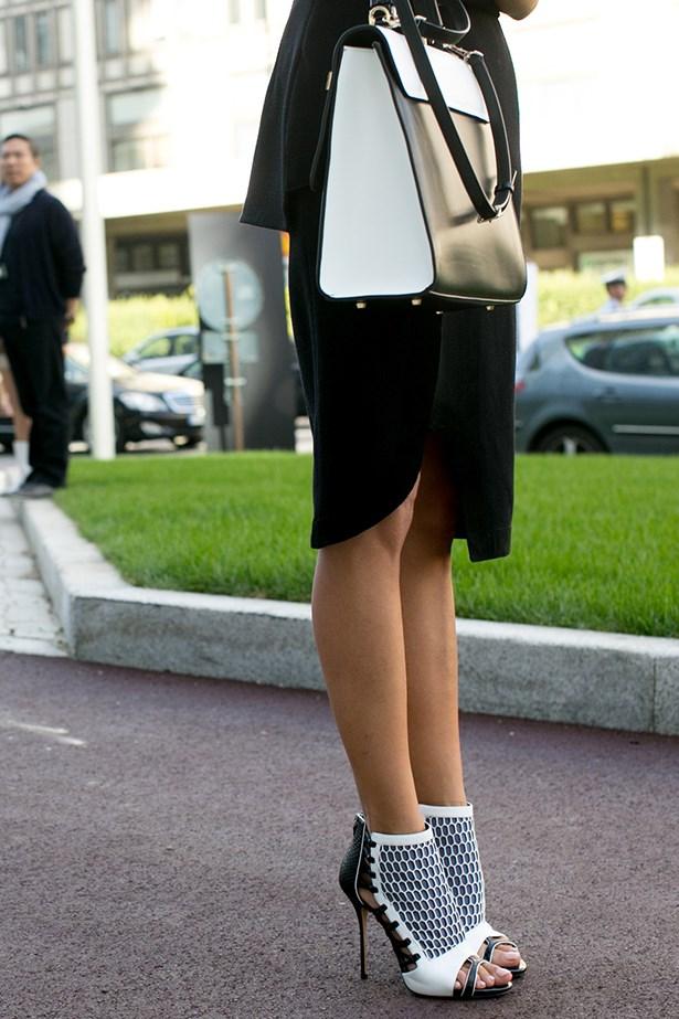 A Milan fashion week attendee wearing statement heels