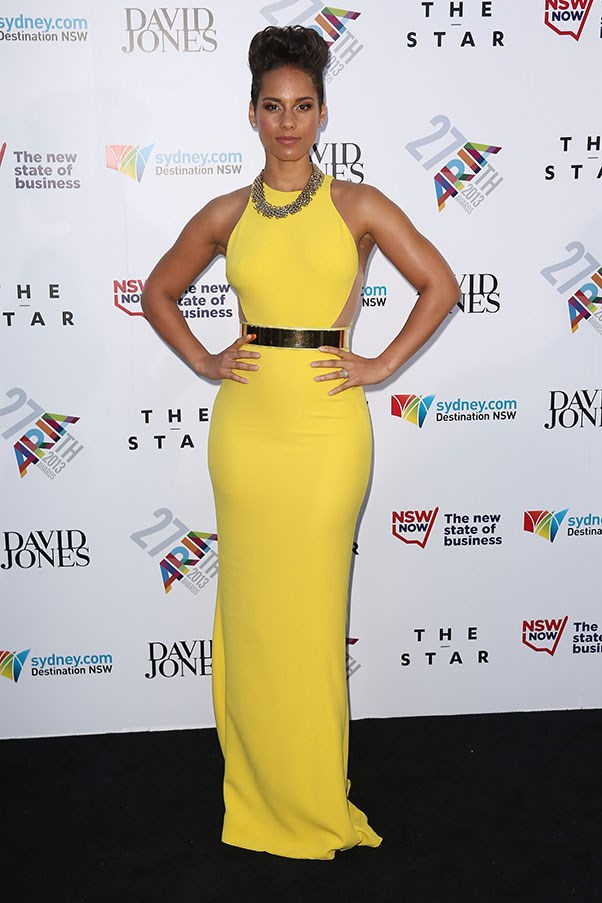 Alicia Keys brought an international element in bright yellow Stella McCartney