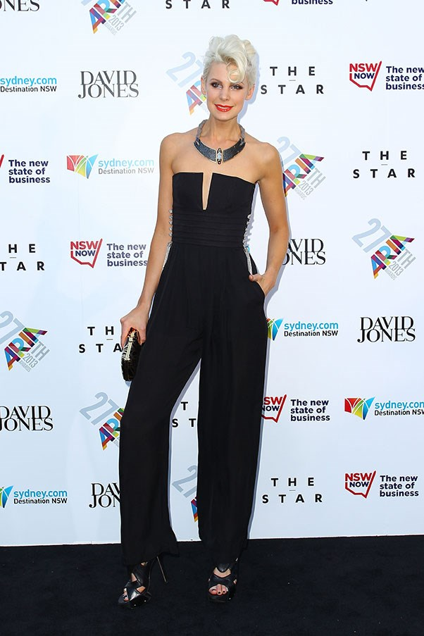 Kate Peck emphasised her very long neck with a black and silver jumpsuit and chunky statement necklace.