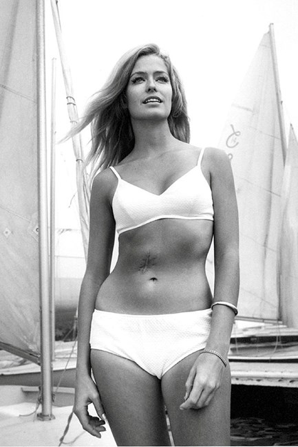 Farrah Fawcett in a high-waisted white bikini