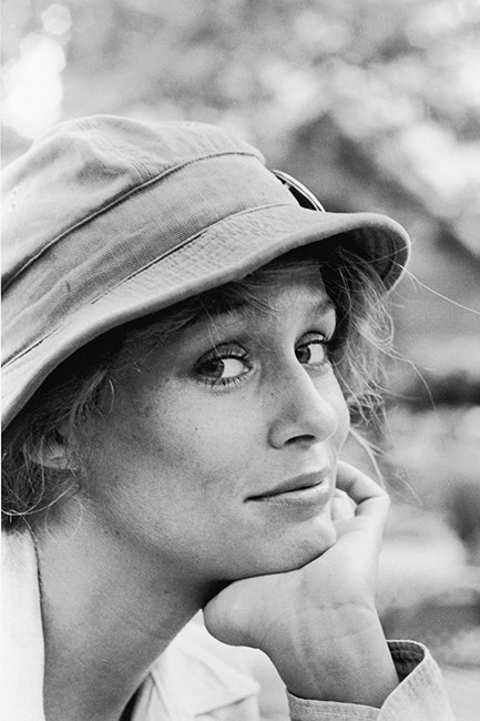 Lauren Hutton wearing a safari hat while in the wilderness