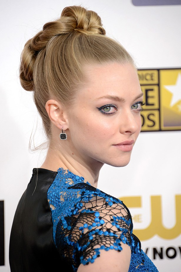 Seyfried's locks were woven intricately into a high chignon, accompanied by electric blue winged eyeliner at the 18th Annual Critics Choice Movie Awards earlier this year.