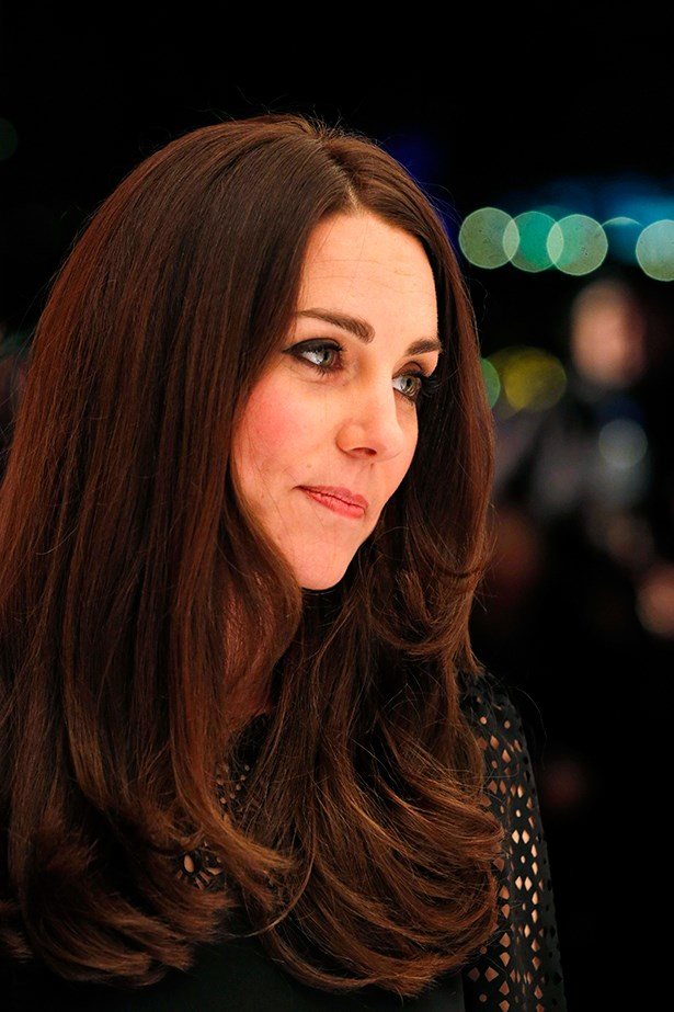 Duchess Kate showed off her newly glossy brown locks by wearing her hair out.