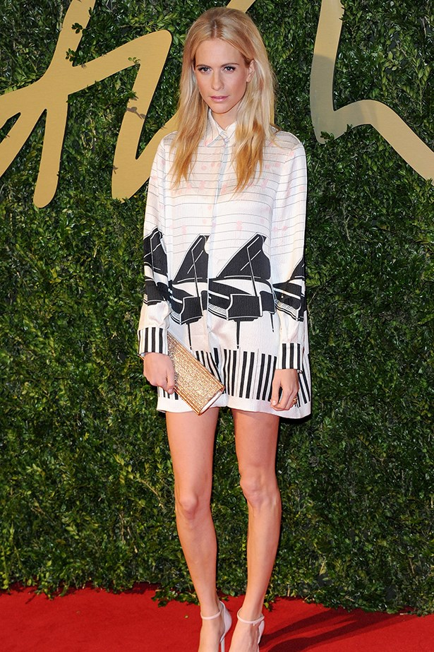 Poppy Delevingne took a break from her hen's festivities and wore a piano print Emilia Wickstead dress to the event.