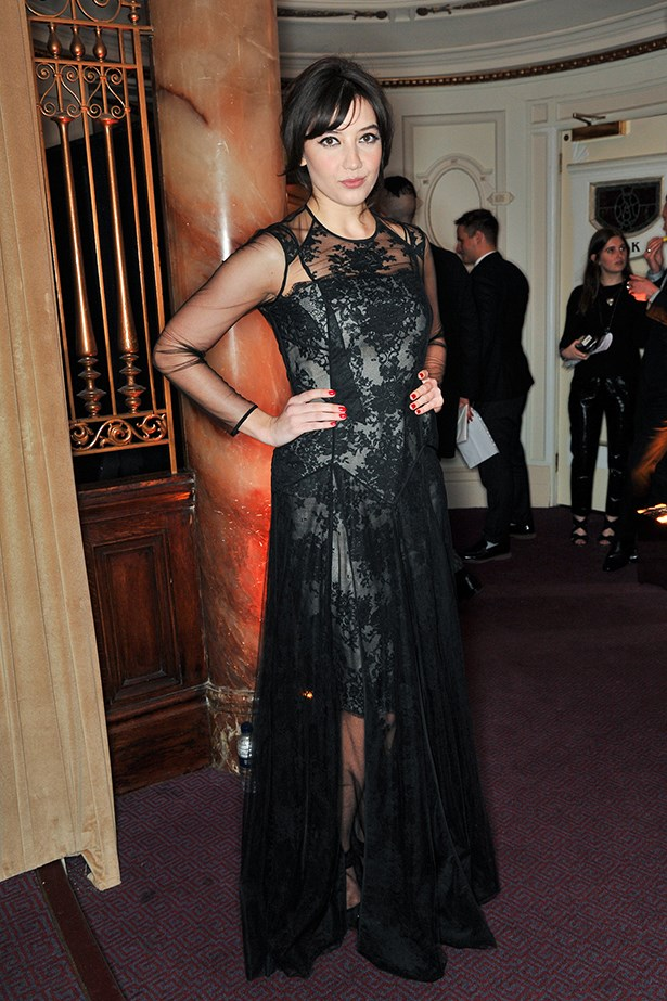 Daisy Lowe wore her hair in a messy up-do with a black lace dress.
