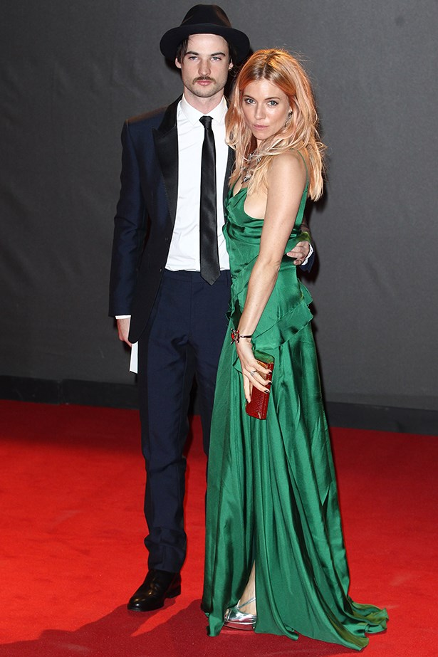 Sienna Miller looked elegant in a Burberry Prorsum dress with husband Tom Sturridge by her side.