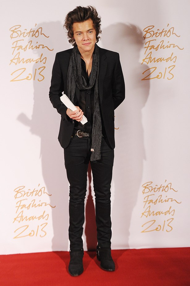 Harry Styles wore a Saint Laurent blazer and jeans with a scarf to the event.