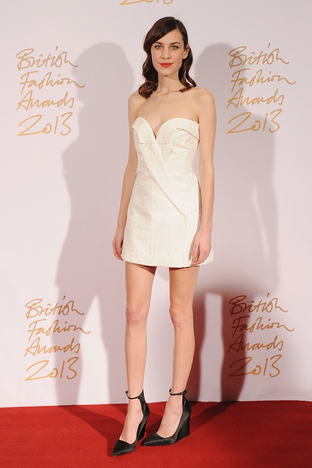 Alexa Chung wore a Stella McCartney dress with Burberry heels and a bright orange-red lip.