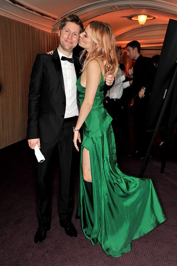Sienna Miller plants a kiss on Burberry CEO Christopher Bailey.