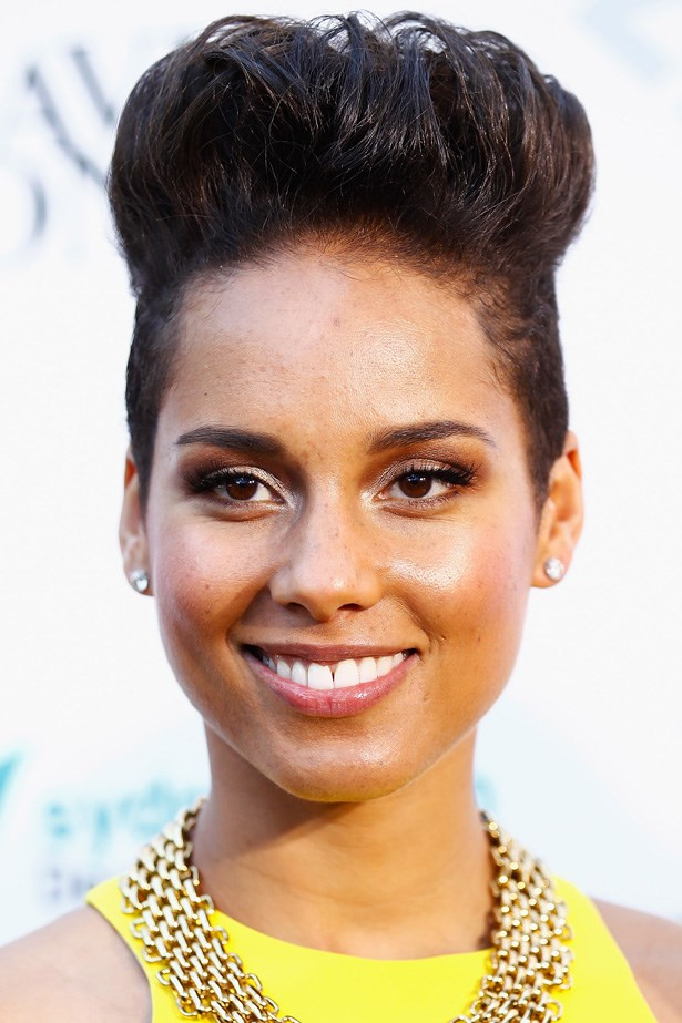 Alicia Keys embraces an extreme updo with a gravity defying style.