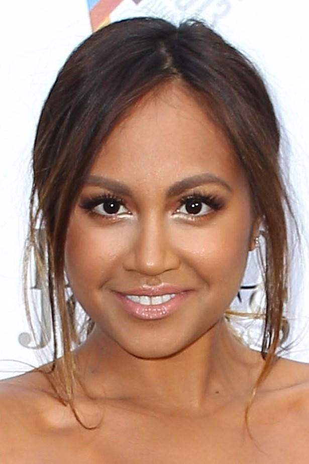 Jessica Mauboy glows with illuminated skin, bright eyes and glossy lips.