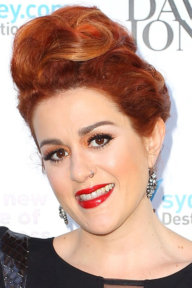 Katie Noonan matches her eye shadow to her hair with lashings of mascara and daring orange glitter.