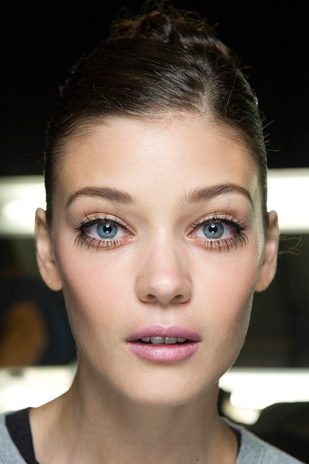 Twiggy-inspired but with a modern bend at Caroline Herrera SS14: long lash extensions on the upper and lower lash lines finished with a flick of liquid liner.