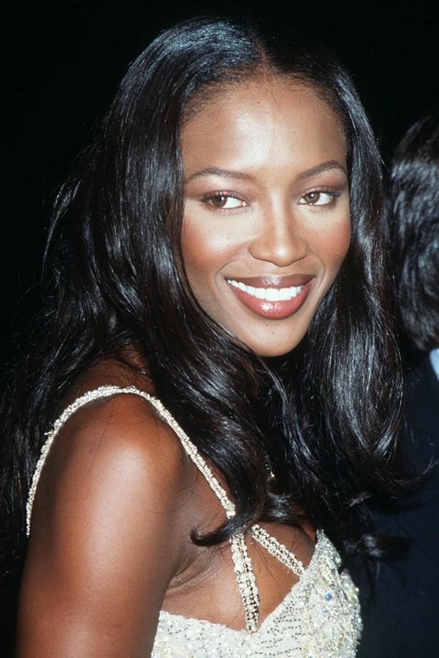 Fresh faced Naomi Campbell showcases lightly defined eyes and bronzed cheeks at a Tommy Hilfiger event in 1998.