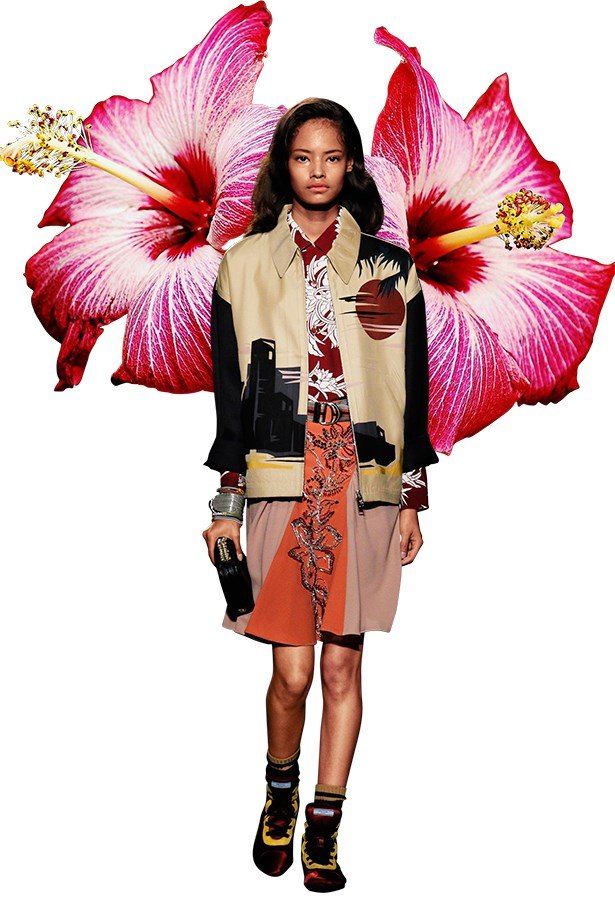 Prada's Menswear SS14 runway was awash with male and female models head-to-toe in tropical prints and sunset inspired hues.