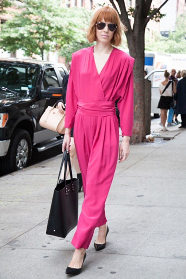 A New York fashion week attendee wearing a hot pink jumpsuit
