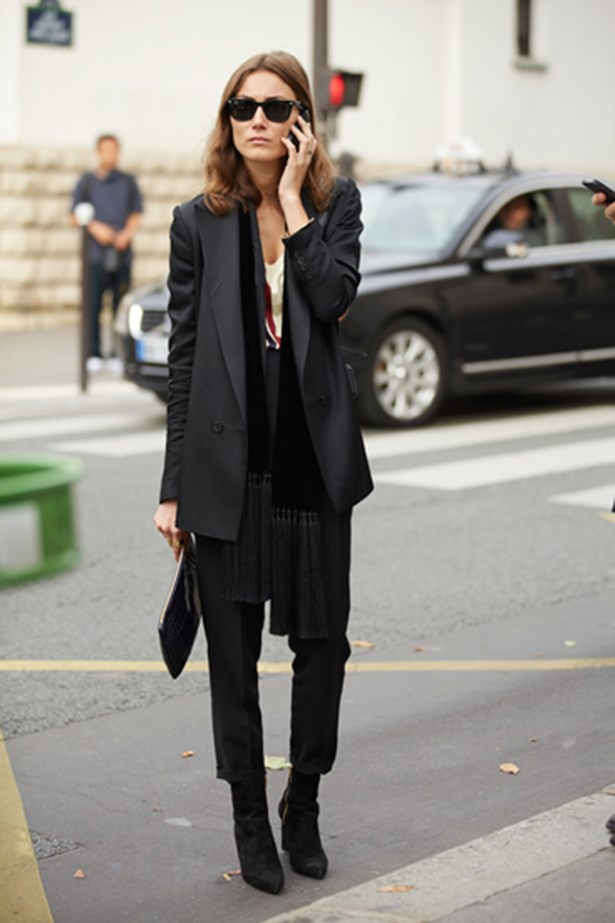 Fashion week attendee wearing head-to-toe black