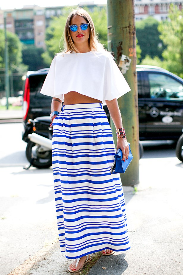Fashion week attendee in a blue and white maxi skirt
