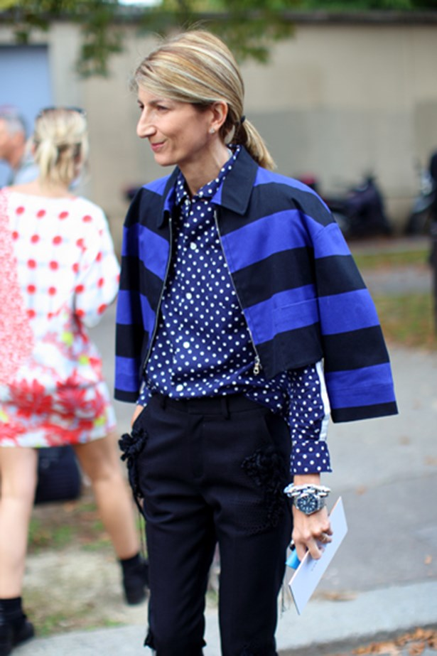 Fashion week attendee in a blue skirt and jacket