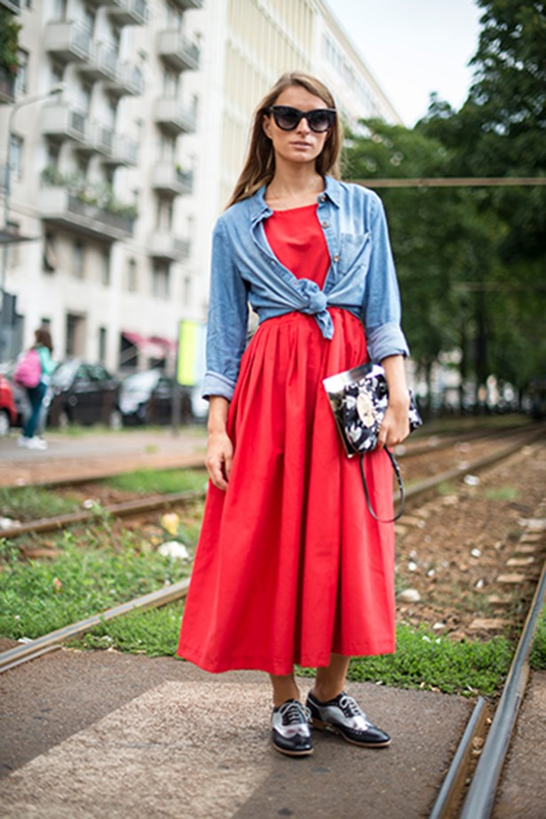Milan fashion week attendee wearing a red dress
