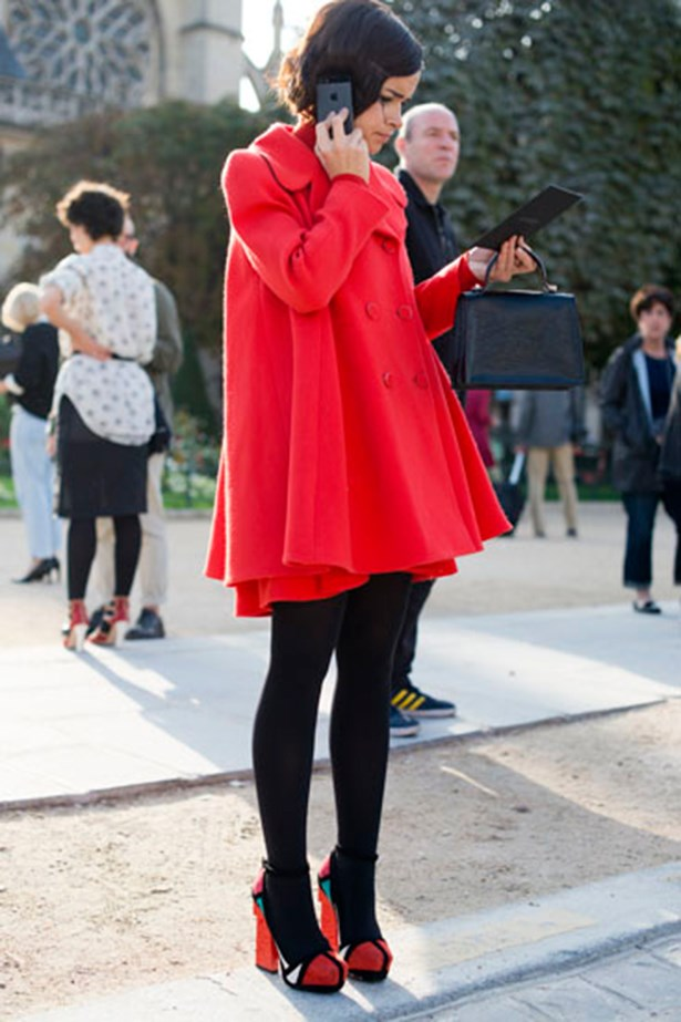 Miroslava Duma in a red coat and dress