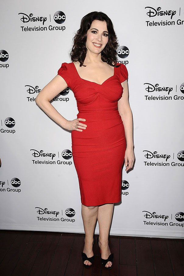 Lawson wears a form-fitting red dress at a Disney press tour in California in January of 2013.