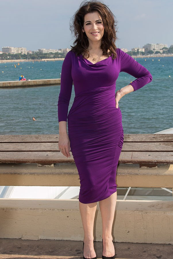 Lawson in a flattering purple jersey gown at a Nigellissima press call in Cannes in 2012.
